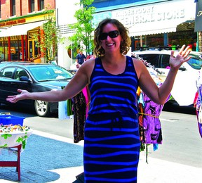 Soon the cars behind Downtown Kingston's Alex Amodeo will vanish and be replaced with a burst of vendors for the annual Princess Street Promenade, scheduled to take place Aug. 3.                    (ASHLIEGH GEHL - KINGSTON THIS WEEK)