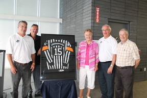Central Hockey League official Steve Cruickshank, left, gets some help unveiling his referee sweater from friend Andy Attleberry, his mother Marie, CHL referee-in-chief Bryan Lewis and Brant Mayor Ron Eddy to honour his 1,000 games with the CHL in the U.S. during a sweater ceremony at the Brant Sports Complex on Thursday, July 18, 2013. MICHAEL PEELING/The Paris Star/QMI Agency