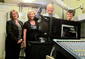 Bonnie Lavergne, Fran Catenacci, Bob Dell and Susie Beynon show off cineSarnia's new Christie DCP digital projector. Group members say the new digital projection will provide enhanced picture quality, making film showings an even better experience for the group's more than 500 subscribers and rush ticket buyers. LIZ BERNIER / THE OBSERVER / QMI AGENCY