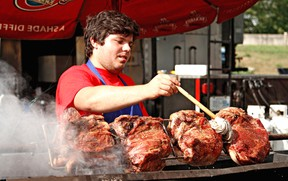 Mike Greey keeps a close eye on his barbecue during the 2012 Kinsmen Ribfest. This year's event will be Aug. 9 to 11 at Cockshutt Park. (Expositor file photo)
