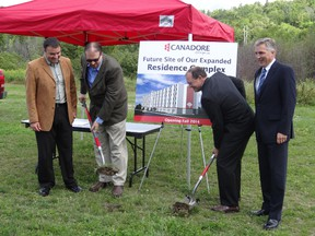 Shawn Chorney (left to right), vice-president of Enrolment Management and Student Services; William Ferguson, chair of Canadore College board of governors; Mayor Al McDonald; and Brian Freeman, Campus Living Centres vice-president, officially break ground on the college's third apartment complex. Construction is slated to start later this week.