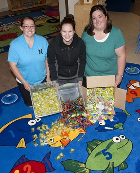 TAYLOR WEAVER HIGH RIVER TIMES/QMI AGENCY Christine Scherer-Smith, Nikki Gass and Michelle Kessle from The Parent Link Centre are eagerly awaiting the arriving of school supplies and backpacks so they can help get students ready for the upcoming school year.