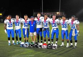 Sherwood Park coach Scott Smith poses with his receiving corps at the recent Football Canada Cup. Photo supplied