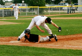 White Sox first baseman Scott Hornstra stretches out to haul in a throw, and double off a Fort Saskatchewan runner, during the final regular season league game for the Sox, who won 7-6. - Gord Montgomery, Reporter/Examiner
