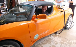 Christopher Misch, vice-president of Sun Country Highway, showed off the new fully-electric Tesla Roadster at Leader Resources on July 31, 2013. He will be visiting numerous municipalities to get the conversation started about green transportation. (ALANNA RICE/KINCARDINE NEWS)