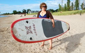 Pam Rantz opened Kincardine Stand Up Paddle Board Rentals in June 2013 on Station Beach and hasn't slowed down since, even in the recent poor weather. (ALANNA RICE/KINCARDINE NEWS)