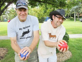 MONTE SONNENBERG Simcoe Reformer Brian Johnston of Port Dover, left, and Todd Nunn of Simcoe repeated as champions Saturday at the Simcoe Rotary Friendship Festival bocce tournament in Wellington Park. (MONTE SONNENBERG Simcoe Reformer)