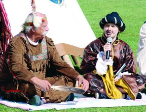 In this file photo, Roger Fleury (left) portrayed Chief Tessouat and Claudia Gleason portrayed Samuel de Champlain during a reenactment of Champlain's arrival on Morrison Island 400 years ago.