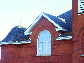 New shingles have been installed that mimic the look of a old fashioned slate roof.