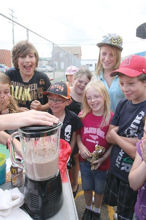 """Children of the Boys and Girls Club react as a Happy Meal gets blended for their """"fear factor"""" challenge Aug. 1."""
