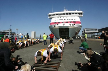 """Estonia's strong man team pulls """"Baltic Queen"""", a 21,746 ton passenger ferry, in Tallinn on May 20, 2011. The athletes set a new world record for the heaviest weight pulled by manpower, organizers said. (REUTERS/Ints Kalnins)"""