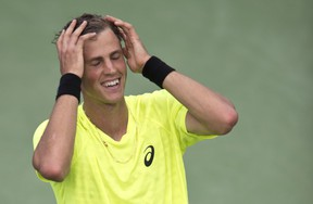 Canadian Vasek Pospisil celebrates after upsetting Czech Tomas Berdych to reach the quarterfinals of the Rogers Cup in Montreal, August 8, 2013. (MARTIN CHEVALIER/QMI Agency)