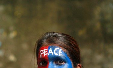 A student participates in a peace rally to commemorate the 68th anniversary of the atomic bombings of the Japanese cities of Hiroshima and Nagasaki, in Mumbai on August 6, 2013. (REUTERS/Danish Siddiqui)