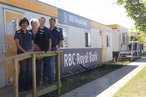 KEVIN RUSHWORTH HIGH RIVER TIMES/QMI AGENCY. Royal Bank of Canada staff are open and operational in their tempoary location on 12th Avenue and third street.