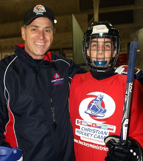 Hockey Ministries International hockey school co-ordinator and HHN Honoured Member Brent Tremblay poses with one of the camp's participants, Justin Pellerin, from North Bay.