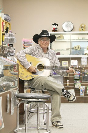 Thane Hughes poses in the new locale of Thane's Music Stop, now in the Wetaskiwin Mall, after years of setting up shop on Main Street.