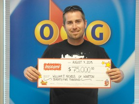 William Nickels with his winning cheque at the OLG Prize Centre in Toronto.