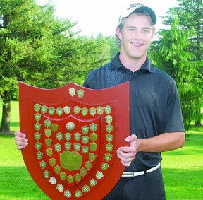Ben Hopkinson holds the Stratford city golf championship shield Sunday after winning the 2013 title with a round of 72 at the Stratford County Club. Hopkinson shot 69 at the Municipal golf course in Saturday's opening round. (STEVE RICE, The Beacon Herald)