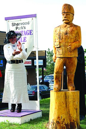 Mayor Linda Osinchuk, in period dress, looks on following the unveiling of the newest addition to Heritage Mile, the Sam Steele sculpture Thursday, Aug. 15. Leah Germain/Sherwood Park News/QMI Agency