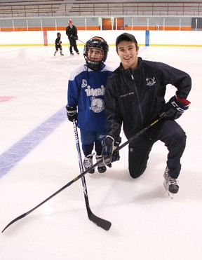 Garrett Meurs of Ripley recently ran a hockey school Kincardine from Aug. 12 to 16 where he taught kids the skills of hockey. Meurs who recently signed an entry level contract with the Colorado Avalanche in March is ready to move forward with his career after playing four successful years with the OHL Plymouth Whalers. Meurs (right) with one of his hockey school kids, seven-year-old Chris Martins who came all the way from Plymouth, Michigan for the week long hockey school.