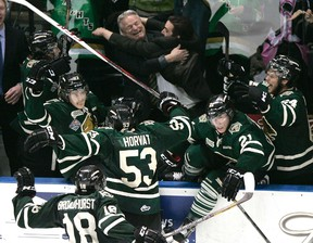 The London Knights bench erupts after video review confirmed Bo Horvat's game winning goal with one-tenth of a second left in the third period of game seven of the OHL championship at Budweiser Gardens against the Barrie Colts in London, Ontario on Monday, May 13, 2013. The Knights have teamed with the Western Mustangs softball program to help provide tickets to underprivileged youth. DEREK RUTTAN/QMI AGENCY