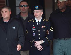 U.S. soldier Bradley Manning is escorted out of a courthouse during his court martial at Fort Meade in Maryland, August, 20, 2013. (REUTERS/Jose Luis Magana)