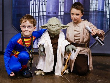 Nicholas Malcolm, 7, dressed a Superman along with brother  David Malcolm , 9, dressed as Luke Skywalker poses for a photo with a model of Yoda at Fan Expo Canada at the Metro Toronto Convention Centre in downtown  Toronto on Friday August 23, 2013. The pop cultural event runs until August 25. (Ernest Doroszuk/Toronto Sun)