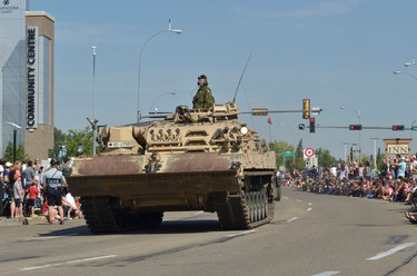A tank rolls by in Sherwood Park, Alta. on Saturday, Aug. 24 during a parade after a key to the county ceremony put on by Strathcona County. The ceremony was part of a celebration marking the 120th anniversary of Strathcona County. Michael Di Massa/Sherwood Park News/QMI Agency
