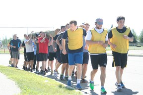 The Drayton Valley Thunder's main camp Aug. 19-21 involved some innovative new training such as team building drills like jogging while carrying a heavy log. The drill, developed by assistant coach Jack Redlick from his work with Edmonton Police Services, brought the new players together.
