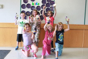 """Kenneth MacRitchie, 8, Ella MacRitchie, 9, Peyj Woykin, 9, Ally-Ann Romanschuk, 8, Abby Mombourquette, 8, and Kaycie Turcotte, 9, show off their worry dolls and """"I'm soda lighted you're my teacher"""" instructor gift at Central School at the back to school camp organized by Team For Sucess on Aug 22. Celia Ste Croix   Whitecourt Star"""