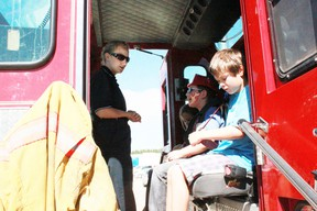 Firefighter Taya Green shows Jorja Amiot, 6, Ashton Zimmer, 9, and Pearson Amiot, 9, around the fire truck at the Whitecourt Early Learning Market and Barbeque on Saturday, Aug 17. Celia Ste Croix | Whitecourt Star