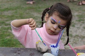 Elianna Chum turned three on Monday so she celebrated her birthday at the NEOFACS picnic getting her face painted, painting rocks and bouncing in the castles.