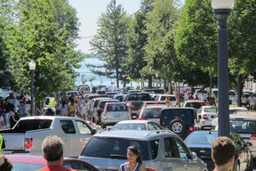 Lower Albert Street became a one-way street Sunday as parents and their children arrived at Queen's University campus for move-in day. (PETER HENDRA The Whig-Standard)