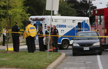 Emergency personnel at the scene in front of Elia Middle School on Sentinel Rd. in the Keele St. and Finch Ave. area of Toronto after a girl was struck and killed by a turning dump truck on Tuesday, September 3, 2013. (Dave Thomas/Toronto Sun)