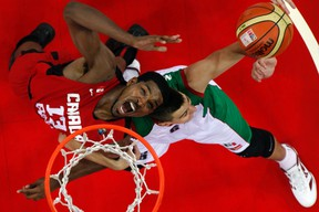 Canada's Tristan Thompson (left) attempts to go for a basket against Mexico's Roman Martinez during their FIBA Americas Championship. (REUTERS/Carlos Garcia Rawlins)