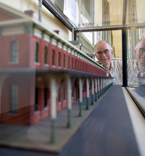 North America Railway Hall of Fame historian Laurence Grant, looks at model of Canada Southern Railway station in the hall's newly completed gallery to be opened Sept. 17. Tuesday, Sept. 10, 2013. (Eric Bunnell, Times-Journal)