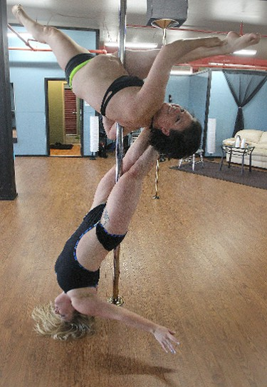Fantasy Pole Dancing co-owners and instructors Tahea Mack (top) and Elisha Ewonchuk work out during an open house at their new location on Logan Avenue on Sat., Sept. 14, 2013 in Winnipeg, Man. KEVIN KING/Winnipeg Sun/QMI Agency
