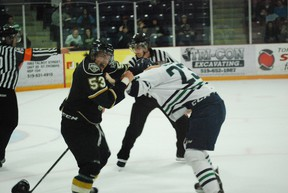 London Knights prospect Chris Maton, left, tussles with Plymouth Whalers winger Connor Sills late in the third period of a preseason game at the Timken Centre in St. Thomas on Saturday, Sept. 14, 2013. London lost 5-1 in a game that raised funds for the St. Thomas Minor Hockey Association. Ben Forrest/QMI Agency/Times-Journal