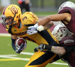 The Ottawa Gee-Gees took on the Queens Gaels during CIS football action in Ottawa On, Saturday Sept 21, 2013. Justin Chapdelaine ran the ball up the middle against the Gee-Gees Saturday. The Gaels defeated the Gee-Gees 36-21.  Tony Caldwell/Ottawa Sun/QMI Agency
