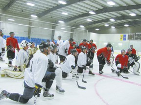 The would-be Whitecourt Wilds gather to hear instructions from their head coach, Allan Measures, a former professional who played in Finland for 14 years after playing for in the Vancouver Canucks farm system. Ann Harvey | QMI Agency