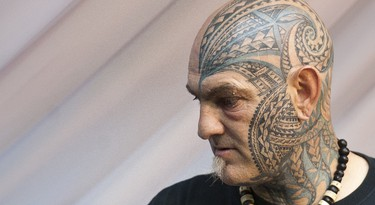 A picture shows a man with facial tattoos at the London Tattoo Convention in London on September 29, 2013. Over 300 tattoo artists from around the world are showcasing their body art in 26 halls at the convention which also features live music and tattoo competitions. AFP PHOTO / WILL OLIVER