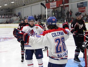 Strathroy Rockets forwards Dan Chapman and Tyler Coleman celebrate a third period goal against the Lambton Shores Predators at the West Middlesex Memorial Centre Sunday. After dropping the home opener vs. Leamington a night earlier, Strathroy bounced back with a 5-2 win, improving their record to 5-2. JACOB ROBINSON/AGE DISPATCH/QMI AGENCY