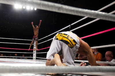 Anthony Birchak, left, celebrates his win as Tito Jones picks himself up during the MFC 38 fight card at the Shaw Conference Centre in Edmonton, Alta. on Friday, Oct. 4, 2013. Birchak won the fight. Amber Bracken/Edmonton Sun/QMI Agency
