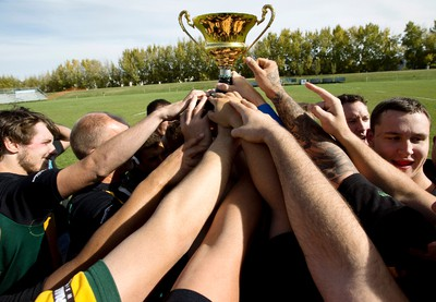 The Grande Prairie Centaurs celebrate with the Visser Cup after beating the Edmonton Nor'Westers at the Edmonton Rugby Union 2013 City Finals at Ellerslie Rugby Park in Edmonton, Alta., on Saturday, Sept. 28, 2013. Grande Prairie won the cup. Ian Kucerak/Edmonton Sun/QMI Agency