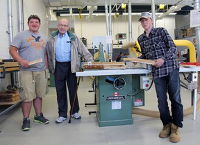 SDCI students Kyle Lacey and Sean-Lucas Ayris present former teacher and Strathroy Seniors Centre representative Gary Burton with a number of wooden cardholders. The two youngsters created a number of holders after Burton expressed a need for them at the local centre. JACOB ROBINSON/AGE DISPATCH/QMI AGENCY