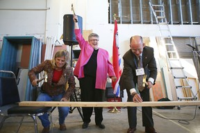 Mary Margaret Dauphine of Independent Living Centre Kingston, centre, celebrates the start of renovations of a new Home Base Housing facility  along with HBH board president Bill Dobson and Kingston city councillor Sandy Berg. (Elliot Ferguson The Whig-Standard)
