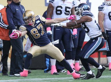 Winnipeg Blue Bombers WR Rory Kohlert is shoved out of bounds by Toronto Argonauts DB Ricardo Colclough during the fourth quarter of CFL action at Investors Group Field in Winnipeg, Man., on Sat., Oct. 19, 2013. Kevin King/Winnipeg Sun/QMI Agency