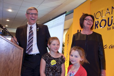 Mayor Nolan Crouse, his wife Gwen, and their granddaughters Carolyn and Samantha stand onstage moments after he is re-elected mayor on the evening of Oct. 21 in the St. Albert Inn. Mayor Crouse won 55% of the votes against contender Shelley Biermanski who garnered 44.8%, with 20 out of 20 polls reporting.  Photo by Grant Cree