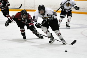 Jalen Aitcheson (9) of the Mitchell Hawks breaks through the neutral zone while being chased by Walkerton Blackhawks' forward Drew Davidson during OHA Western Jr. C hockey league action Saturday. Walkerton dumped the locals, 5-1. ANDY BADER/MITCHELL ADVOCATE