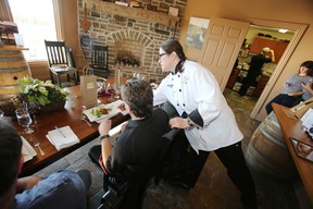 Prince Edward County chef Lili Sullivan of East and Main restaurant serves members of the media invited to sample what this year's edition of Countylicious has to offer during a presentation held at Keint-he Winery and Vineyeards in Wellington last Friday. - JEROME LESSARD/The Intelligencer
